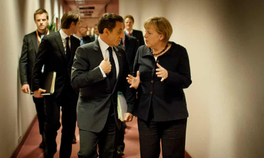 Merkel speaking with the then French president, Nicolas Sarkozy, at the EU headquarters in Brussels on 22 October 2011.