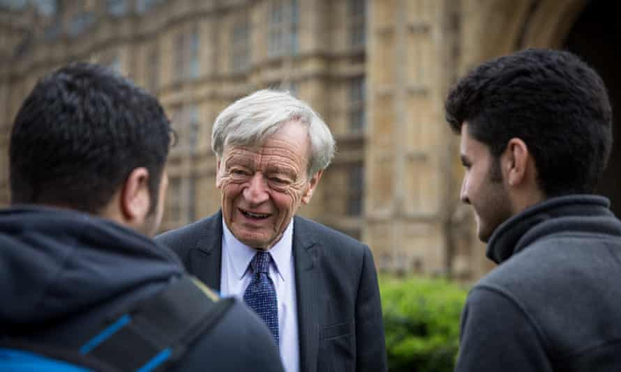 Lord Alf Dubs speaks to two child refugees from Syria.
