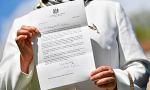 Fatima Boudchar holds up a written apology from Theresa May over the UK's role in Boudchar and Belhaj's rendition and torture.
