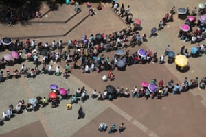Sao Paulo, BrazilUnemployed people line up to get a password for participation in a job opportunities event