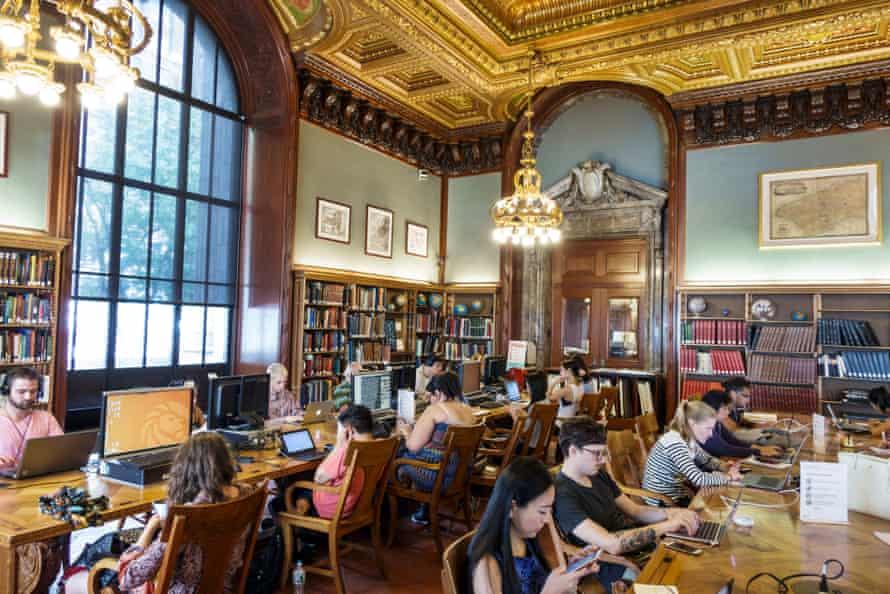People use computers at New York Public library