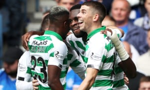 Odsonne Édouard celebrates with his Celtic teammates after opening the scoring at Ibrox