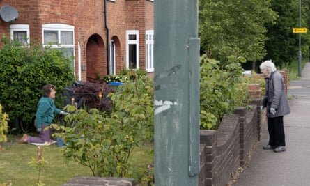 Neighbours chatting in a socially distanced way