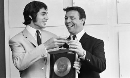 Engelbert Humperdinck, left, celebrates his Golden Disc for The Last Waltz with the song's writer, Les Reed