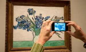 USA, New York City, Manhattan, East Side, Metropolitan Museum of Art, Woman Taking Picture Using an iPhone, Iris By Van Gogh. Image shot 06/2012. Exact date unknown.ECKRCB USA, New York City, Manhattan, East Side, Metropolitan Museum of Art, Woman Taking Picture Using an iPhone, Iris By Van Gogh. Image shot 06/2012. Exact date unknown.