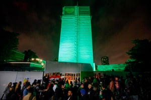 People stage a midnight vigil near Grenfell Tower