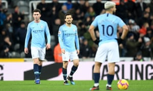 David Silva of Manchester City and Aymeric Laporte of Manchester City look dejected after Newcastle United score their second goal.