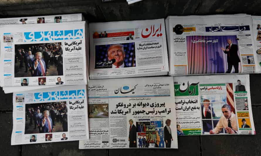 A picture shows Iranian newspapers displaying articles on US president-elect Donald Trump after his election.