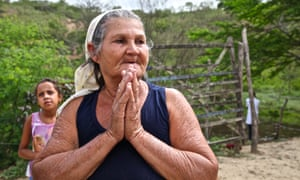 A Brazilian lady mourning the loss of a relative.