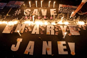 Activists hold a candlelight vigil outside the Indonesian embassy in Makati, Philippines.
