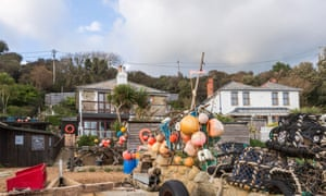 The Crab Shed with colourful buoys at Steephill Cove
