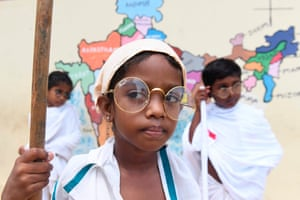 Chennai, India. Students dress up as Mahatma Gandhi during a school event to mark Gandhi's 150th birthday