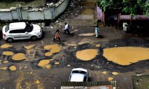 Huge potholes appear in Mumbai, India after heavy rains