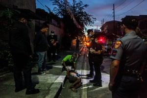 A crime investigator examines the body