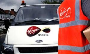Virgin Media staff wearing orange jacket next to a Virgin Media van.