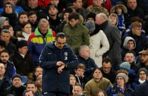 Maurizio Sarri checks his watch.