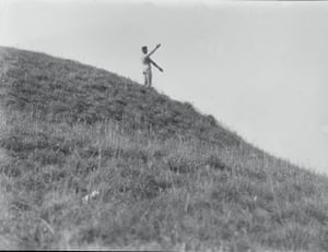 Angus McBean stands naked on Silbury Hill during the Wessex pilgrimage, 1929