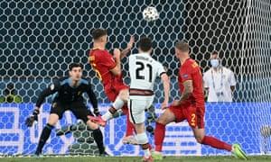 Portugal's Diogo Jota shoots over.