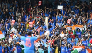 India fans applaud Rohit Sharma of India after he scores 100 runs.