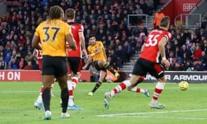 Raul Jimenez of Wolverhampton Wanderers scores to put the visitors ahead.