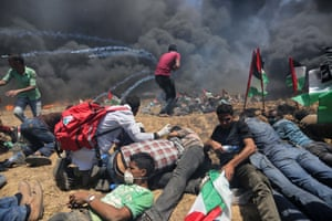 Palestinians set tyres on fire to disrupt Israeli forces in during the protests on Monday