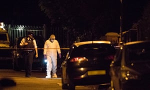 Police at the scene of the attack on the west Belfast home of Gerry Adams.