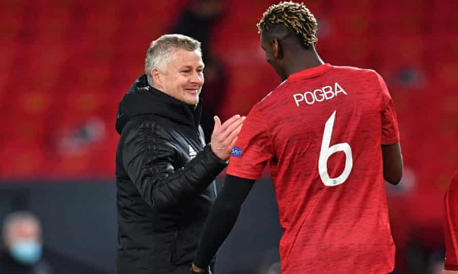 Manchester United's manager, Ole Gunnar Solskjær, congratulates Paul Pogba, who impressed in the Europa League win over Roma.