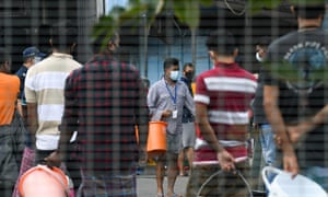 Residents queue for food at the Tuas South foreign workers dormitory that has been placed under government restriction as a preventive measure against the spread of coronavirus in Singapore on 19 April 2020.