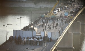 Iraqi security forces block the road to the Green Zone
