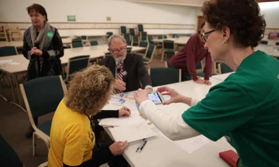 Precinct workers in Iowa count paper ballots after the Democratic presidential caucus.