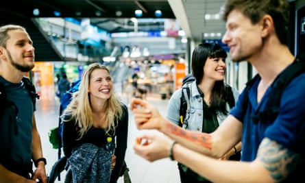 Group of young backpackers having fun at an airport gate