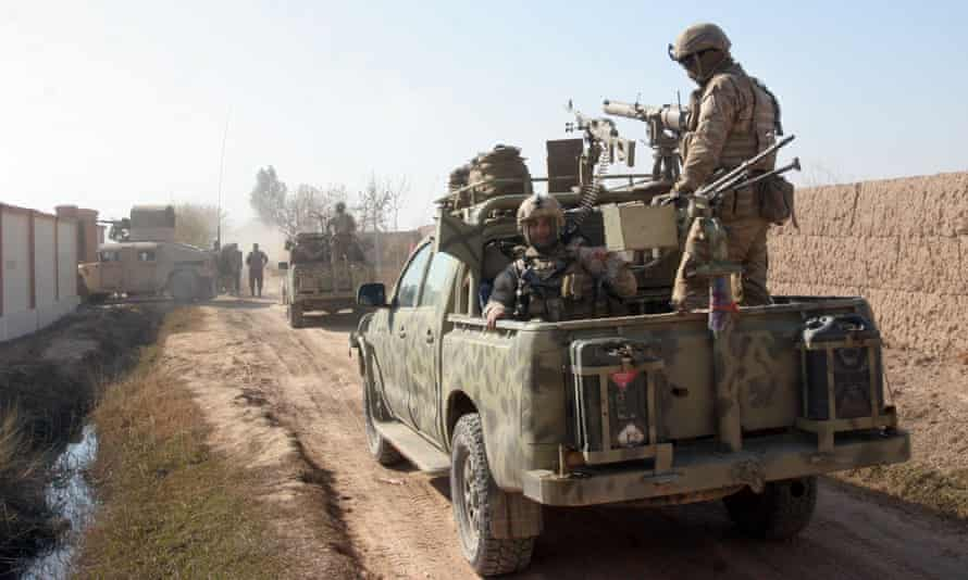 Afghan security forces patrol in Nad Ali district of Helmand province, Afghanistan.