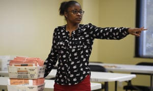 A Georgia election worker moves provisional ballots following the 2018 midterm elections.