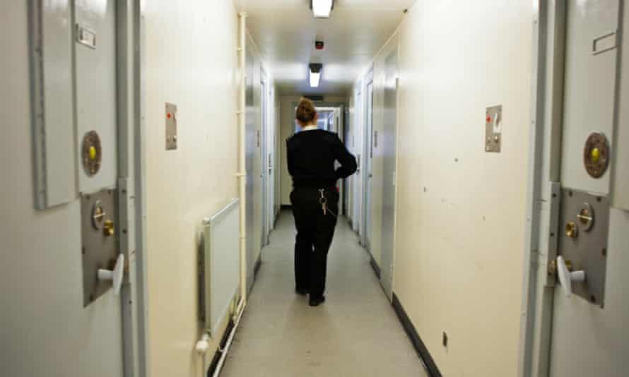 Prison warder in corridor