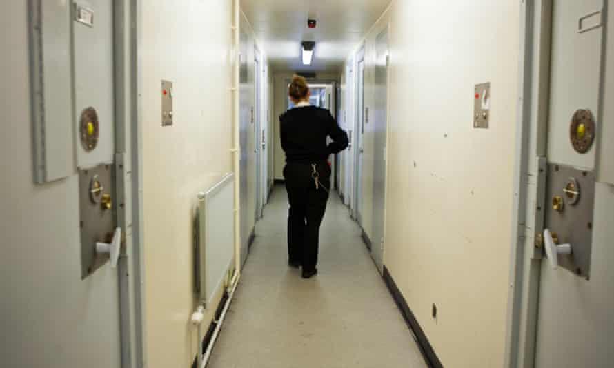 A female prison officer patrolling a women's prison in Surrey.