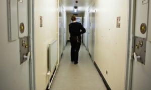 A prison officer walks down the corridor at HMP Send women's prison