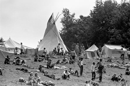 Visitors lying on the grass at Woodstock, August 1969.