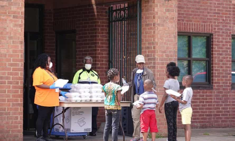 Children come to a community center in north Memphis for food each day since the schools have closed down due to the coronavirus in April.