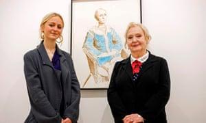 Scarlett Clark, the granddaughter of Celia Birtwell, right, beside a David Hockney portrait of Scarlett.
