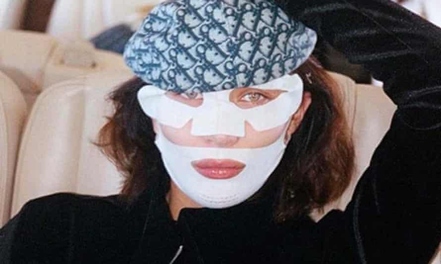 Bella Hadid in a sheet-mask selfie.