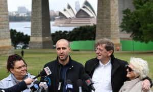 Bim Ricketson (second left), the nephew of Australian film-maker James Ricketson, attends a press conference with Ricketson's daughter Roxane Holmes (left) and brother Peter Ricketson (second right) in Sydney on Monday.