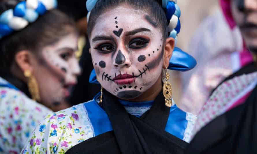 A group of young girls prepare for a performance during the Day of the Dead celebration at the Hollywood Forever Cemetery in Los Angeles, California on 28 October 2017.