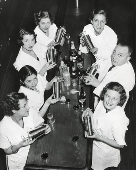 Smiling men and women with cocktail shakers at the end of prohibition.