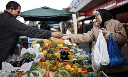 A woman shops at a London street market