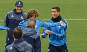 Cristiano Ronaldo laughs during training as Real Madrid prepare for the visit of PSG in the Champions League.