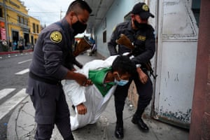 Guatemala City, Guatemala Prison guards carry an inmate with Covid-19 symptoms into a unit of the San Juan de Dios hospital