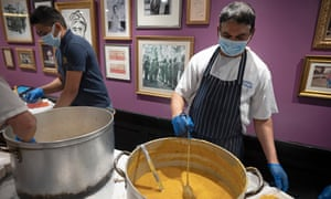 Food is cooked at the Punjab restaurant, Covent Garden, for homeless people in London.