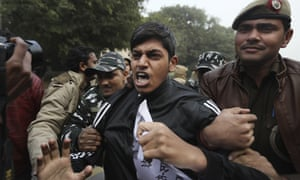 Policemen detain students protesting during a protest against a new citizenship law in New Delhi in December.