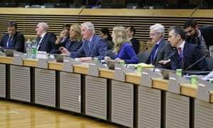 Michel Barnier (centre) with colleagues at the start of negotiations.