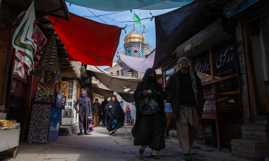 People walk through the bazaar in Murad Khani, Kabul's old town; an area that has seen much destruction over the last decades, but is now being restored.